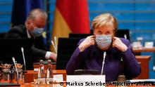 German Chancellor Angela Merkel wears a mask
