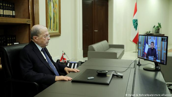 Michel Aoun looking at screen