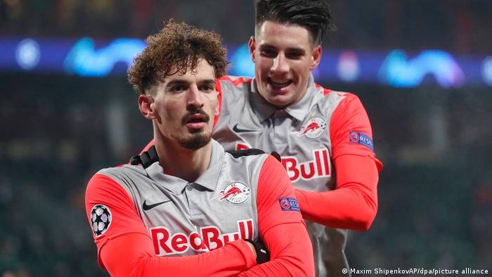 Dominik Szoboszlai (left) folds his arms after scoring a goal in the Champions League