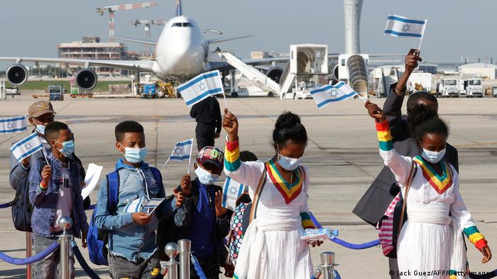 Ethiopian Jewish immigrants making their Aliyah (Immigration to Israel) arrive at Ben Gurion International Airport