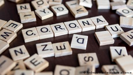 The word 'Corona' spelled with Scrabble letters