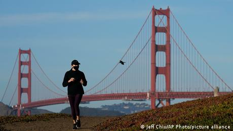 A jogger at Golden Gate Bridge, California, USA