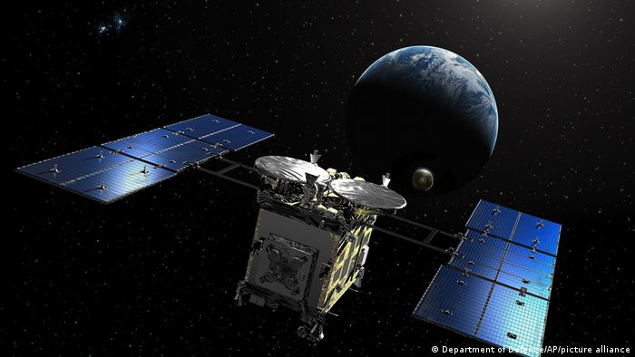 The Japanese Hayabusa2 probe and Earth in an illustration