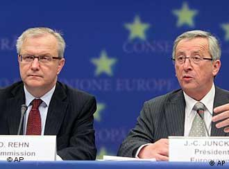 EU Commissioner for Economic Affairs Olli Rehn, left and Luxembourg Prime Minister Jean-Claude Juncker