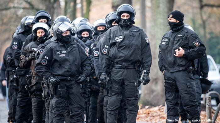 Bremen police patrol an area where a banned anti-lockdown protest took place