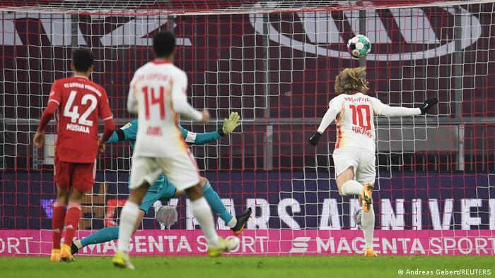 Emil Forsberg heads in a goal