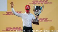 December 6, 2020, Sakhir, Bahrain: MICK SCHUMACHER of Germany and Prema Racing on the championship podium after winning the 2020 FIA Formula 2 Championship at the Bahrain International Circuit in Sakhir, Bahrain. Sakhir Bahrain - ZUMAg147 20201206_zap_g147_019 Copyright: xJamesxGasperottix