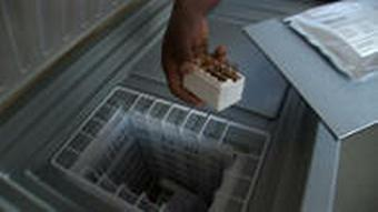 Medicines being taken out of a refrigerator