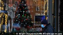 November 18, 2020, Kiev, Ukraine: A man wearing a face mask walks past a shop window already decorated for Christmas during the coronavirus crisis..In Ukraine over the past day 12,496 new cases of the coronavirus disease COVID-19 were recorded. Ukraine Health Ministry recorded a total of 570,153 infections, 10,112 death and 259,079 recovered since the beginning of the outbreak. Kiev Ukraine - ZUMAs197 20201118_zaa_s197_099 Copyright: xSergeixChuzavkovx