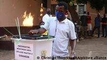 ACCRA, GHANA - DECEMBER 07: A man casts his vote at a Wisconsin University during 2020 Ghanaian general election in Accra, Ghana on December 7, 2020. Christian Thompson / Anadolu Agency