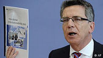 German Interior Minister Thomas de Maiziere presenting crime statistics last month