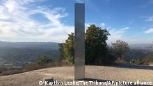 02.12.2020 A monolith stands on a Stadium Park hillside in Atascadero, Calif., Tuesday, Dec. 2, 2020. Days after the discovery and swift disappearance of two shining metal monoliths half a world apart, another towering structure has popped up, this time at the pinnacle of a trail in Southern California. Its straight sides and height are similar to one discovered in the Utah desert and another found in Romania. (Kaytlyn Leslie/The Tribune (of San Luis Obispo) via AP)
