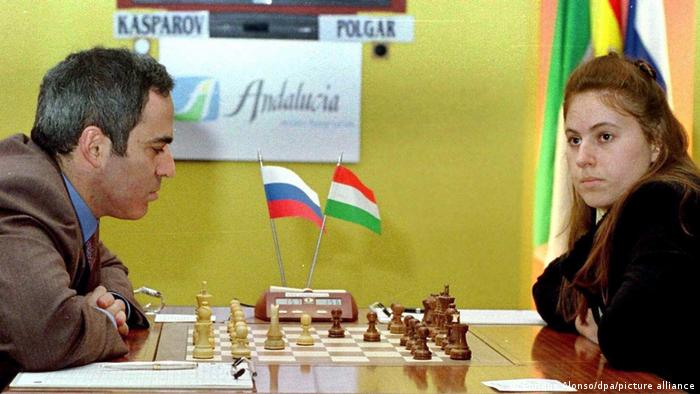 Judit Polgar looks away from the board during a game with Russian Garry Kasparov