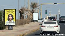 A billboard featuring a candidate running for Kuwait's parliamentary elections is seen in Kuwait city, on November 22, 2020. (Photo by YASSER AL-ZAYYAT / AFP)