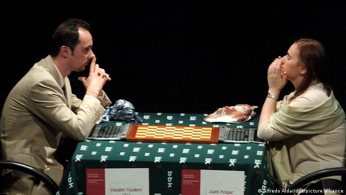 Judit Polgar playing chess at a table with another person
