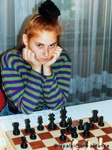 Judit Polgar in 1991 sitting at a chess board