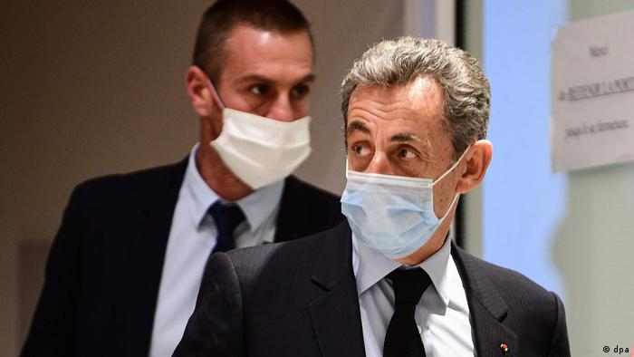 Nicolas Sarkozy leaves court after a hearing