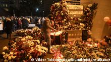 6385363 13.11.2020 A man wearing a face mask lays flowers to honor Belarusian anti-government protester Roman Bondarenko, who was reportedly beaten by the country's security forces, in Minsk, Belarus. Viktor Tolochko / Sputnik