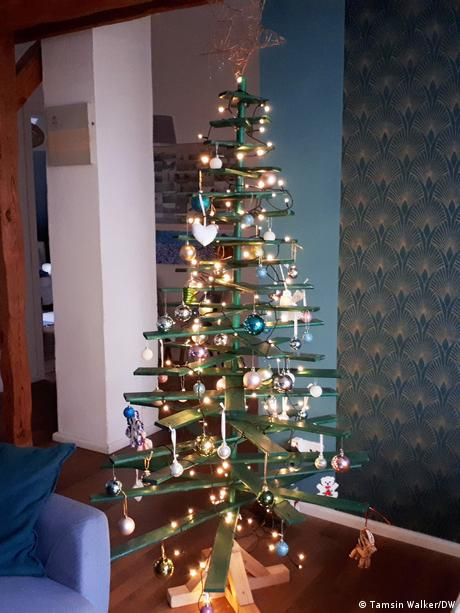 A Christmas tree made from a broomstick and wooden slates