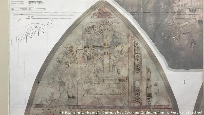 Restoration experts sketched out outlines of what remains of two medieval murals of John the Baptist at the Augsburg Cathedral