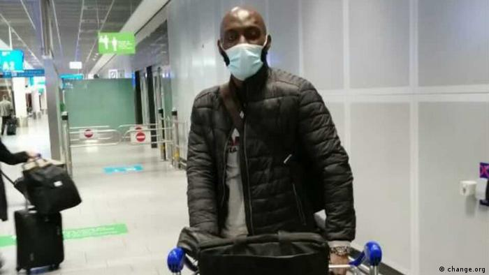 Wilfried Siewa pushes an airport cart with luggage at the aiport in Germany.