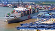 World's largest container ship. An aerial view of the worlds largest ship the OOCL Hong Kong as it arrives at the Port of Felixstowe in Suffolk URN:31937268