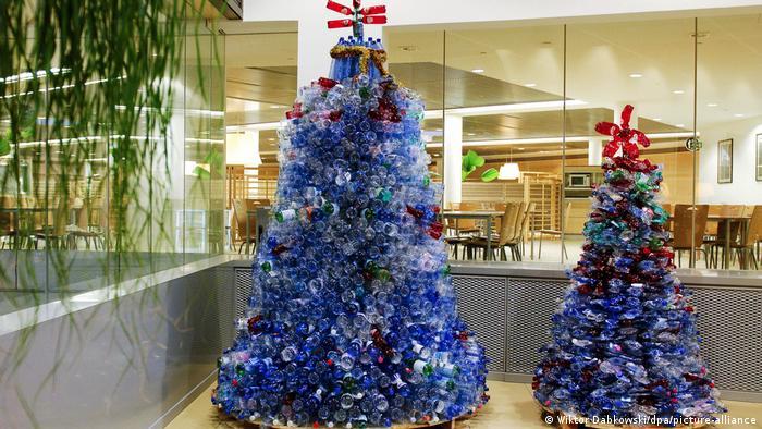 Two Christmas trees made of hundreds of plastic bottles
