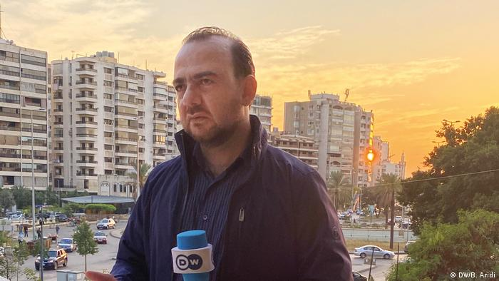 Bassel Aridi, DW correspondent reporting from Beirut at sunset