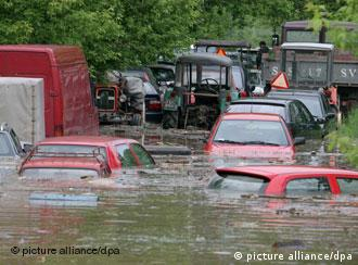 cars floating in flood waters in Poland