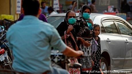 People wearing face masks as a preventive measure against COVID-19 in Karachi