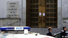 Police officers stand at the entrance of the Paris Museum of Modern Art, in Paris, following the report of five paintings having been stolen, Thursday May 20, 2010. Police and prosecutors say a lone thief has stolen five paintings worth a total of Euros 500 million ($613 million), including works by Picasso and Matisse and Modigliani. (AP Photo/Jacques Brinon)