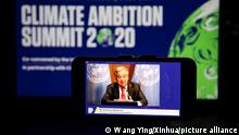 (201212) -- NEW YORK, Dec. 12, 2020 (Xinhua) -- Photo taken in New York, the United States on Dec. 12, 2020 shows a screen displaying UN Secretary-General Antonio Guterres addressing the Climate Ambition Summit via video link. (Xinhua/Wang Ying)