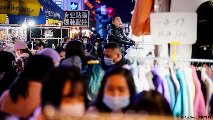 People visit a street market almost a year after the global outbreak of the coronavirus disease (COVID-19) in Wuhan, Hubei province, China December 7, 2020