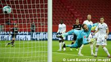 LEVERKUSEN, GERMANY - DECEMBER 13: Leon Bailey (not in the picture) of Leverkusen scores his team's first goal against goalkeeper Oliver Baumann of Hoffenheim during the Bundesliga match between Bayer 04 Leverkusen and TSG Hoffenheim at BayArena on December 13, 2020 in Leverkusen, Germany. Sporting stadiums around Germany remain under strict restrictions due to the Coronavirus Pandemic as Government social distancing laws prohibit fans inside venues resulting in games being played behind closed doors. (Photo by Lars Baron/Getty Images)