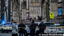 Police officers investigate after a man opened fire outside the Cathedral Church of St. John the Divine in the Manhattan borough of New York City, New York, U.S., December 13, 2020. REUTERS/Jeenah Moon