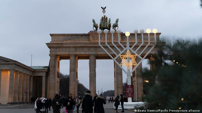 A large light-up menorah in front of the Brandenburg Gate in Berlin