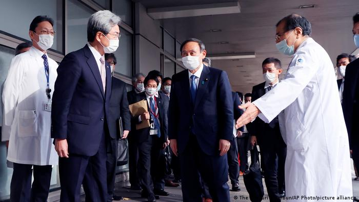 Japan's Prime Minister Yoshihide Suga inspects the front lines of health care at National Center for Global Health and Medicine in Shinjuku Ward, Tokyo on December 14, 2020, amid continuing worries over the new coronavirus COVID-19.
