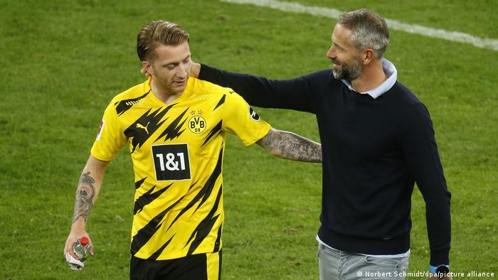 Borussia Dortmund captain Marco Reus with Borussia Mönchengladbach coach Marco Rose