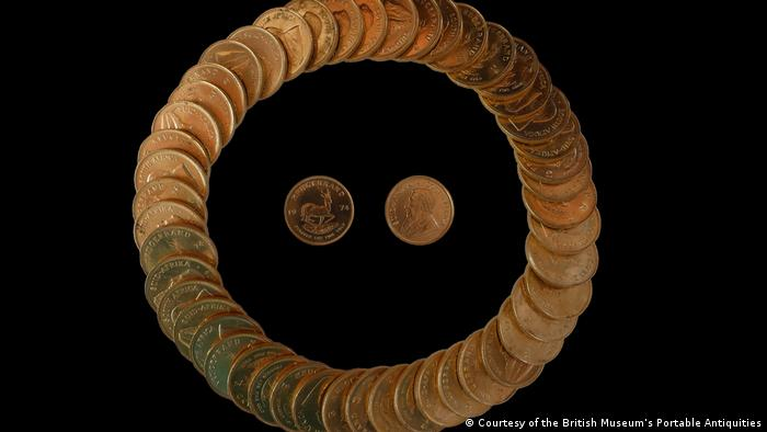 South African Krugerrand gold coins arranged in a circle with two coins in the middle