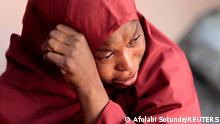 The mother of Muhammad Bello, one the students who was abducted by gunmen, reacts in Kankara, in northwestern Katsina state, Nigeria December 14, 2020. REUTERS/Afolabi Sotunde