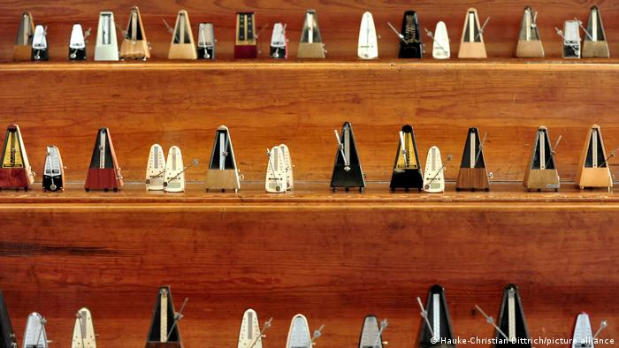 Shelves lined with metronomes.
