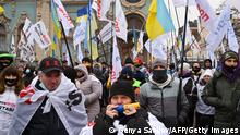 Entrepreneurs and small businesses' owners protest outside the parliament to demand the cancellation of quarantine restrictions imposed to curb the spread of the coronavirus disease, in Kiev on December 15, 2020. (Photo by GENYA SAVILOV / AFP) (Photo by GENYA SAVILOV/AFP via Getty Images)