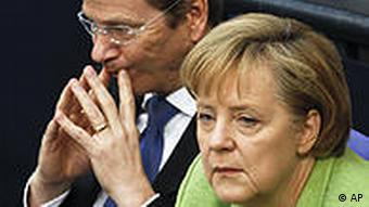 Chancellor Angela Merkel and Foreign Minister Guido Westerwelle during a parliament debate