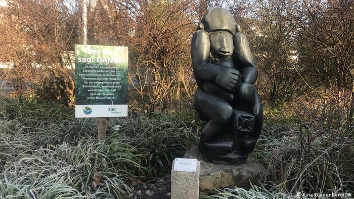 Baboon sculpture with thank-you notice to all the zoo's supporters