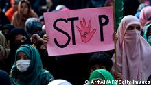 A supporter of Pakistani Islamic political party Jamaat-e-Islami (JI) holds a placard reading Stop during a protest against an alleged gang rape of a woman, in Lahore on September 17, 2020. - Hundreds of women have taken to the streets of cities across Pakistan in recent days after a woman was raped in front of her two children when her car ran out of fuel near the eastern city of Lahore. (Photo by Arif ALI / AFP) (Photo by ARIF ALI/AFP via Getty Images)