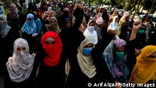 Supporters of Pakistani Islamic political party Jamaat-e-Islami (JI) march during a protest against an alleged gang rape of a woman, in Lahore on September 17, 2020. - Hundreds of women have taken to the streets of cities across Pakistan in recent days after a woman was raped in front of her two children when her car ran out of fuel near the eastern city of Lahore. (Photo by Arif ALI / AFP) (Photo by ARIF ALI/AFP via Getty Images)