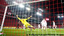 Leverkusen's German defender Mitchell Weiser scores the team's first goal during the German first division Bundesliga football match between FC Cologne and Bayer Leverkusen, in Cologne on Decmber 16, 2020. (Photo by WOLFGANG RATTAY / POOL / AFP) / DFL REGULATIONS PROHIBIT ANY USE OF PHOTOGRAPHS AS IMAGE SEQUENCES AND/OR QUASI-VIDEO (Photo by WOLFGANG RATTAY/POOL/AFP via Getty Images)