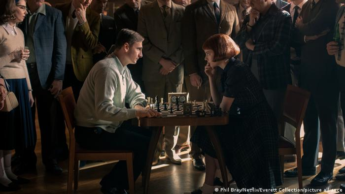 A scene from the series The Queen's Gambit shows Beth playing against a male competitor.