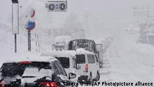 Yuzawa Town is hit by heavy snowfall in Niigata Prefecture on December 17, 2020. Traffic jams and traffic accidents occurred on the road. According to the Japan Meteorological agency, a snowfall is expected to continue in some parts of Japan. ( The Yomiuri Shimbun via AP Images )