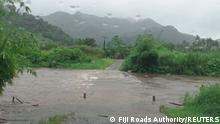 The Bagata Crossing is seen flooded on Vunivesi Road in Savusavu, as Cyclone Yasa passes through Fiji, December 17, 2020, in this photo obtained from social media. Fiji Roads Authority/via REUTERS THIS IMAGE HAS BEEN SUPPLIED BY A THIRD PARTY. MANDATORY CREDIT. NO RESALES. NO ARCHIVES.